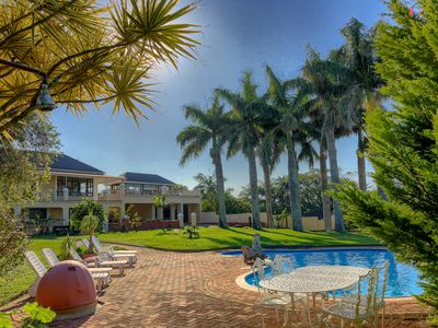 Photo for Apartment in large tropical garden with pool and sea view