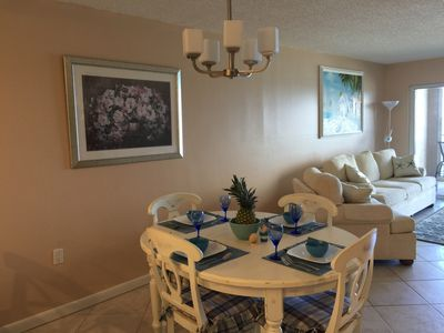 Dining area - table expands w/2 leafs - can seat 6 comfortably 8 if you squeeze