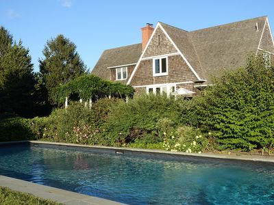 Photo for Tastefully Decorated and Lushly Landscaped Family Retreat with 60' Pool