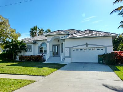 Photo for Private home w/ heated pool just a short walk from Tigertail Beach