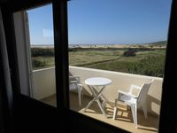 A pleasant upstairs studio apartment with a beautiful view across the dunes