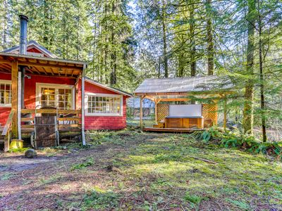 Photo for Creekside, dog-friendly cabin with porch, outdoor fireplace & private hot tub!