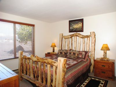Bedroom (1) with queen bed and handmade furnishings, satellite TV