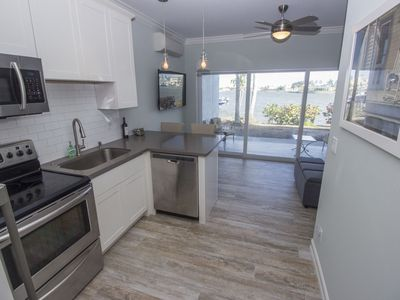 Photo for Newer Renovation Intimate Bay View by Sea Wall Steps to Vanderbilt beach Pets ok