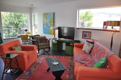 Bright, colourful living space with lots of light and sofa is a single bed