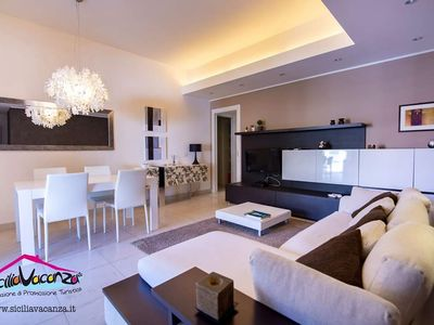 Photo for Elegant apartment in villa 70 meters from the sea.