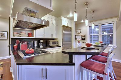 Luxury kitchen with contemporary bar top counter