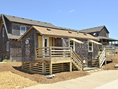 Photo for Beautiful little cottage on the oceanside in the exclusive historical section of Nags Head. Direct, private beach access. Wonderful location for a couple or small family!