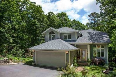 Our custom-built contemporary home is nestled among mature trees and gardens.