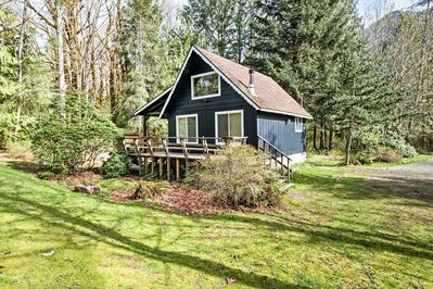The 1-bedroom, 1-bath cabin is located along the banks of the Skykomish River.