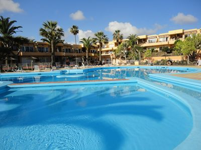 Photo for Las Vistas apartment in Residencial Las Dunas facing private pool wifi