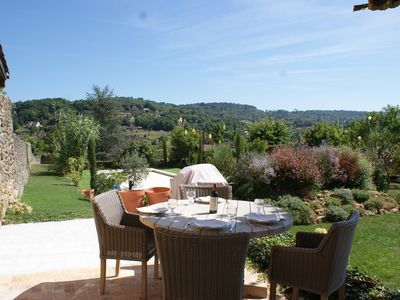 Photo for An ancient, spacious house on the ramparts of Domme: pool, parking. Sleeps 6.