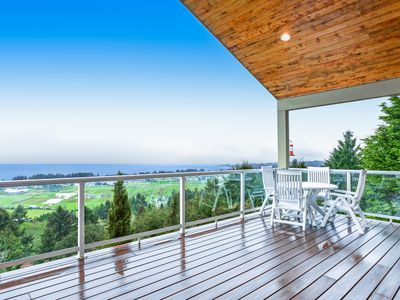 Photo for Expansive hillside home w/ amazing ocean view, decks & home theater