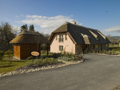 Photo for Luxury thatched cottage sleeps 8 at five star Sheen Falls Lodge Resort