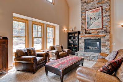 The Living room is a warm open plan with a gas fireplace.