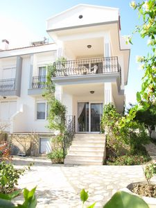 Photo for Ciftlikkoy Villa, Cesme. Lovely, comfortable 3 bed/2 bath villa 100m from sea