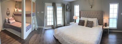 Master bedroom with twin bunks. French doors out to the river
