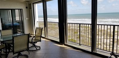 Photo for Penthouse Oceanfront condo with direct beach access and sweeping views.