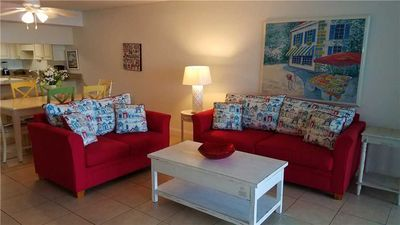 Photo for Bright and Cheery Beachfront Condo and Exclusive Perks!