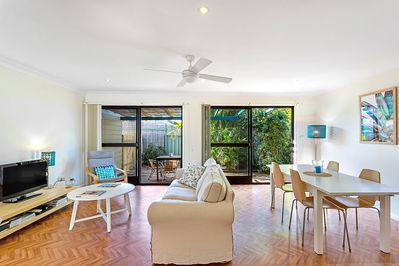 Open plan living and dining area that is welcoming and comfortable for all