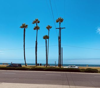 """Photo for Luxury Coastal """"Spa"""" in HB - Steps to sand! All new beach condo!"""
