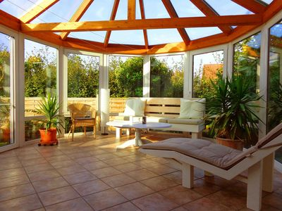 Photo for Cozy apartment with a winter garden, fireplace and barbecue terrace ...