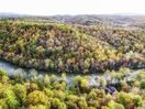 Aerial shot of fall foilage at River`s Edge Lodge