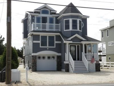 Welcome to 5403 Long Beach Blvd with its Victorian charm and welcoming porch.