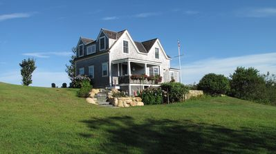 Photo for Charming 4BR Cottage Perched above the Sea Offers Spectacular Ocean Sunsets