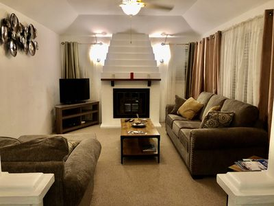Newly decorated living room with fireplace