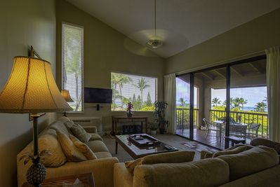 The spacious living room features endless ocean views and a cathedral ceiling.