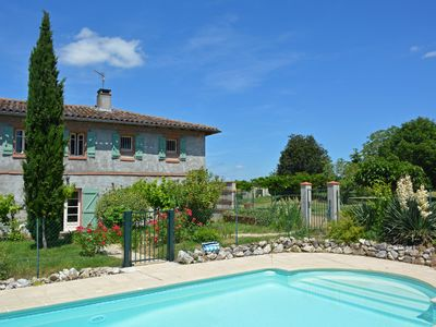 Photo for Beautiful farmhouse with pool, 35 minutes west of Toulouse, family-friendly