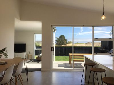 Photo for Modern Mount Home with sunny views - Luxury summer beach getaway
