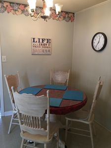Dining area off of the kitchen is a great place to play a game of Canasta!