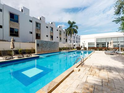 Photo for Stylish apartment with shared pool and great location near beach, town, parks