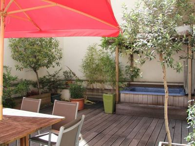 Photo for Beaunier Plein Air apartment in 14ème - Montparnasse with WiFi, private terrace & jacuzzi.
