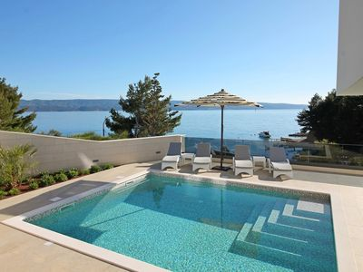 Photo for Luxury, seafront  Villa Petra with heated pool only 50m from the beach