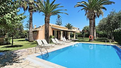 Photo for Beautiful bungalow with pool surrounded by palm trees near beach