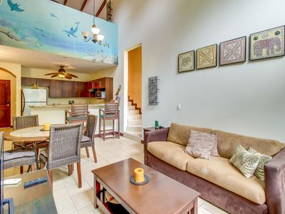 Photo for Breezy condo with shared pool only a quick walk from the beach!