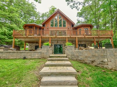 Photo for Pristine Lakefront home with expansive back deck, fire pit & hot tub!