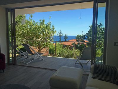 Photo for Ground floor of 5-star villa with beautiful garden, sea view, for two families!