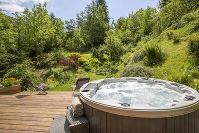 The hot tub and superb garden