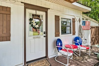 A quaint front porch welcomes you to your Austin abode.