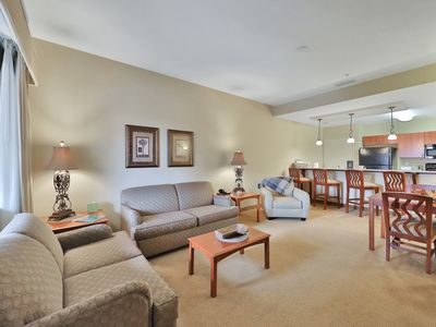 Photo for NEW LISTING! Spacious condo with a shared pool and free WiFi, near shopping!