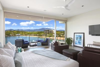 Floor to ceiling glass opens  up to your own private lanai. Float above Kalapaki
