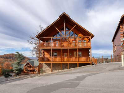 Photo for Lofty log home w/ private hot tub, mountain views & bedroom fireplaces!
