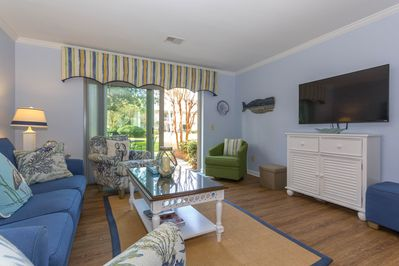 Family room with Plenty of Seating and open ot outdoor patio and courtyard