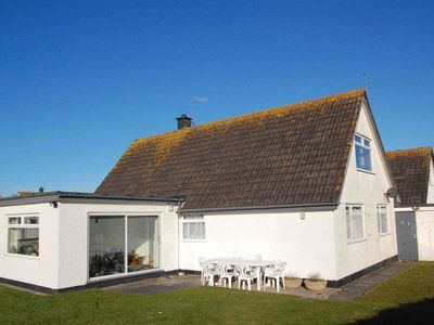 Photo for Murmur y Don Detached house sleeps 6/8, two mins from beach with large garden