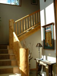 Sunny entryway with log accents gives you the mountain feel!