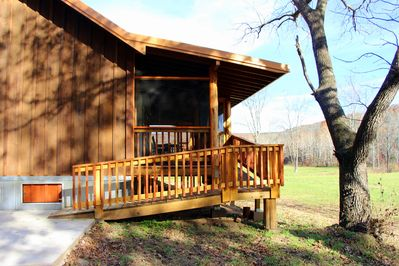 Ramp at back of cabin located on side with screened-in porch.